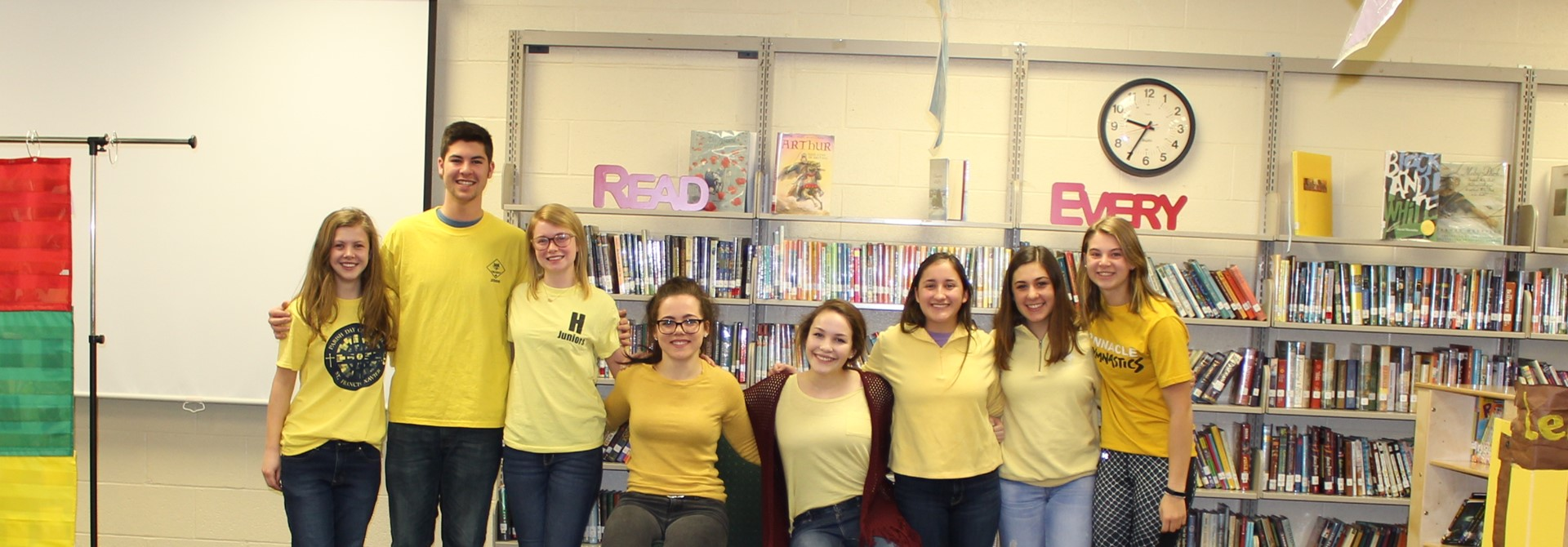 NHS Students Serve as 'Mystery Readers' at Elementary Schools